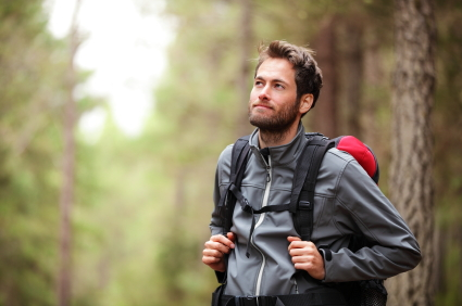 Hiker - man hiking in forest