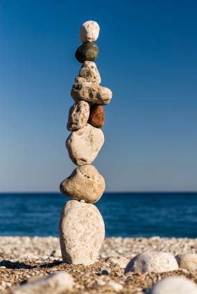 Stones staked in tower on the beach