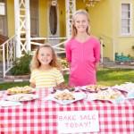 Children Running Charity Bake Sale