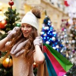 Young with shopping bags and christmas tree