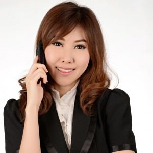 Young business woman calling telephone